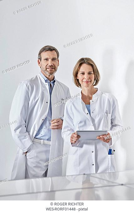 Doctors with tablet