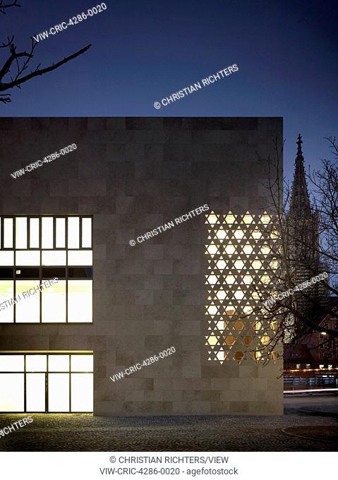 Synagoge am Weinhof, Ulm, Germany. Architect: kister scheithauer gross architects, 2012. Front elevation with illuminated interior at dusk