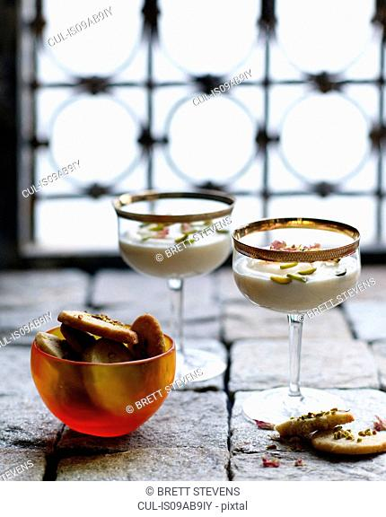 Ground rice dessert with pistachio shortbread