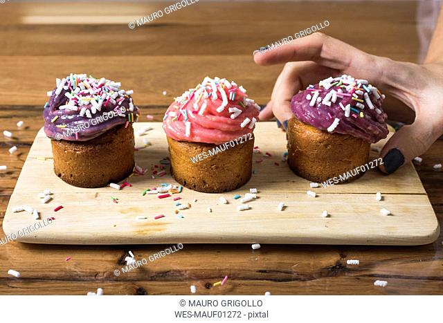 Woman taking muffin