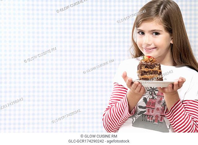 Girl holding a plate of chocolate pastry