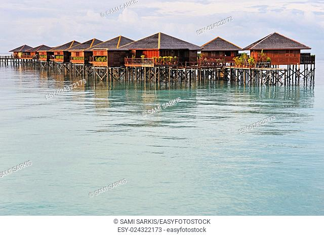 Bungalow vacation resort on lagoon, Island of Borneo, Sabah State, Malaysia, Southeast Asia