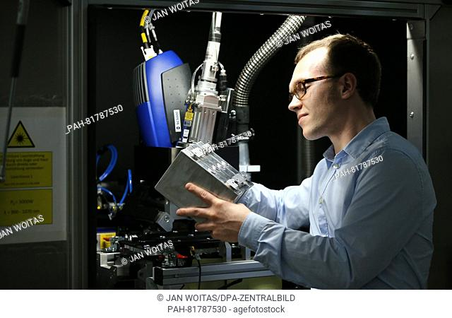 Development Engineer Philipp Just prepares for testing a battery module in the ThyssenKrupp System Engineering GmbH in Limbach-Oberfrohna, 27 June 2016