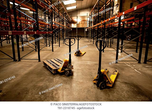 Forklift after paddle in a warehouse, Valencia, Spain
