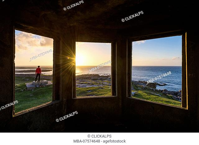 Man looking at Sunset, Fanad Head, County Donegal, Ulster region, Ireland, Europe