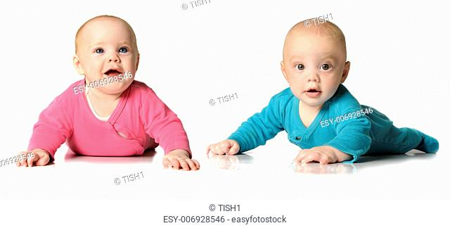 Six month old twin brother and sister on white