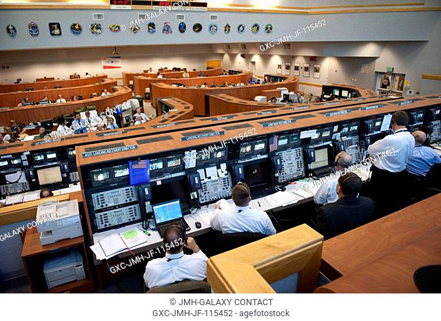 In Firing Room 4 of the Launch Control Center at NASA's Kennedy Space Center in Florida, launch controllers monitor the countdown to launch of space shuttle...