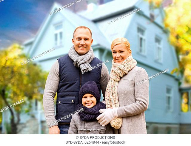 happy family over living house in autumn