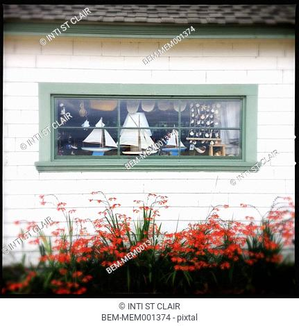 Decorative sailboats in window of house