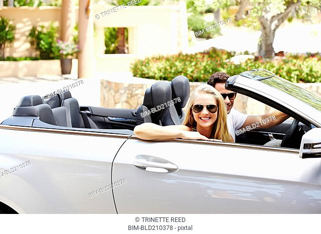 Couple in convertible outdoors