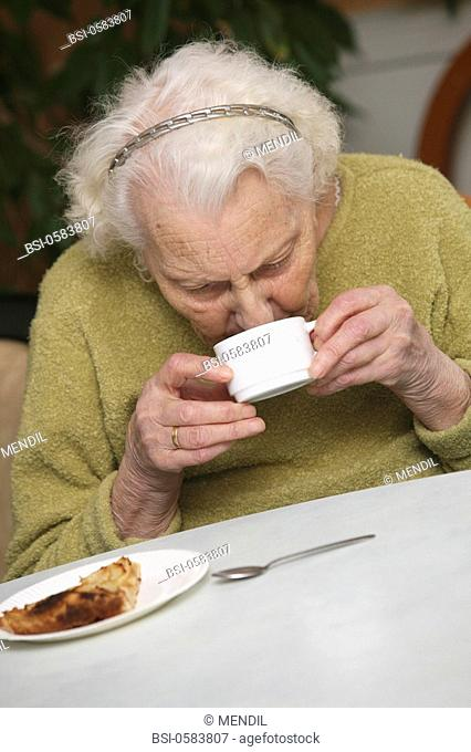 HOME FOR THE AGED Photo essay in a nursing home for the elderly in the department of Aisne, France. Retired woman having her afternoon tea