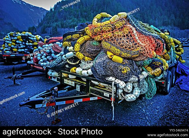Piled up seiner fishing nets on trailers parked outside Silver Bay Seafood, Gary Paxton Industrial Park near Sitka, Alaska, USA