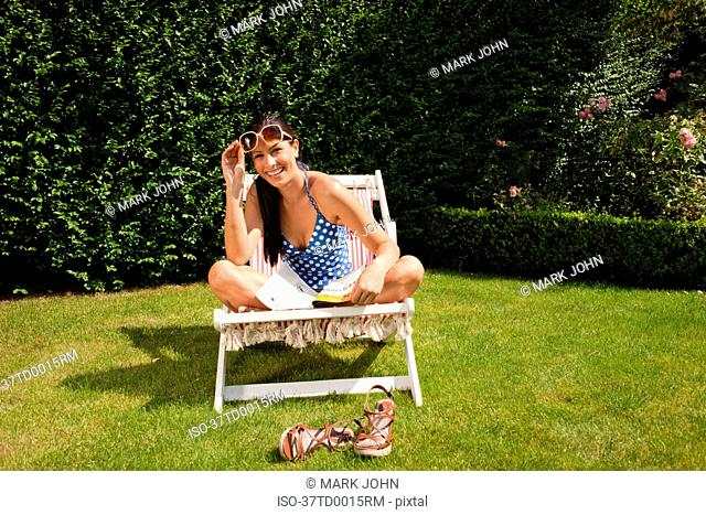 Woman reading and sunbathing