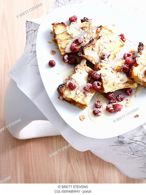 Almond croissant with raspberries and white chocolate sauce