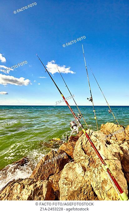Fishing rods at the breakwater. Denia. Alicante. Valencia Community. Spain