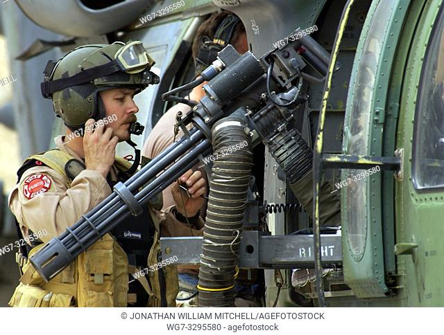 IRAQ -- 08 Apr 2003 -- A gunner from a Special Operations HH60G Pavehawk from the 301st Rescue Squadron prepares for a mission at a forward deployed location in...