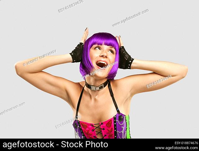 Disco singer in purple hairs and corset