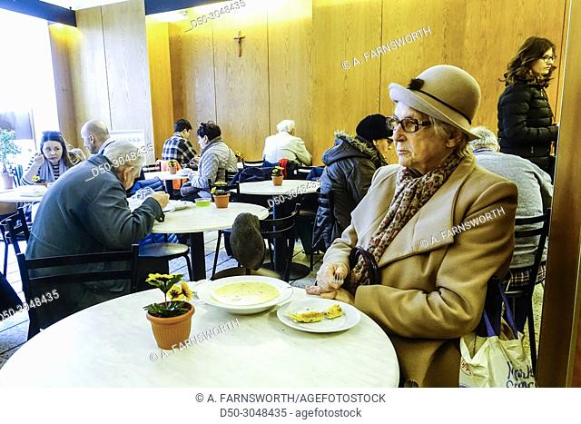 Elderly retired woman eating in a milk bar, a traditional low priced restaurant subsidized by the state. Warsaw, Poland