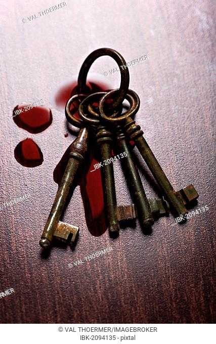 Bunch of old keys and drops of blood