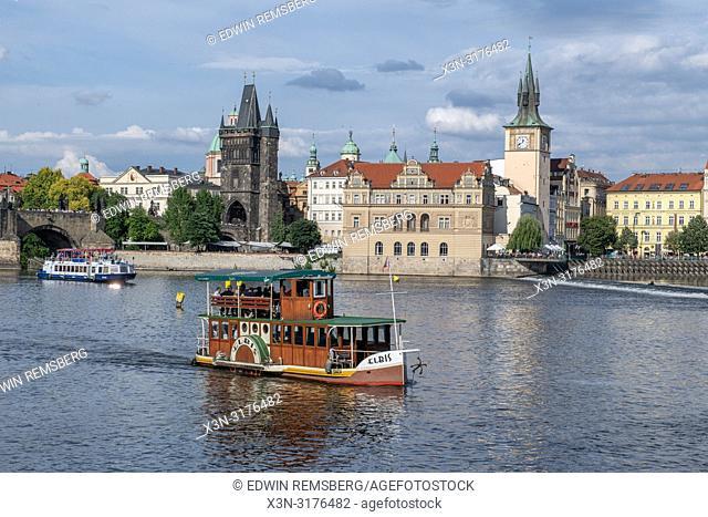 Vltava river with boats in Prague - Czech Republic