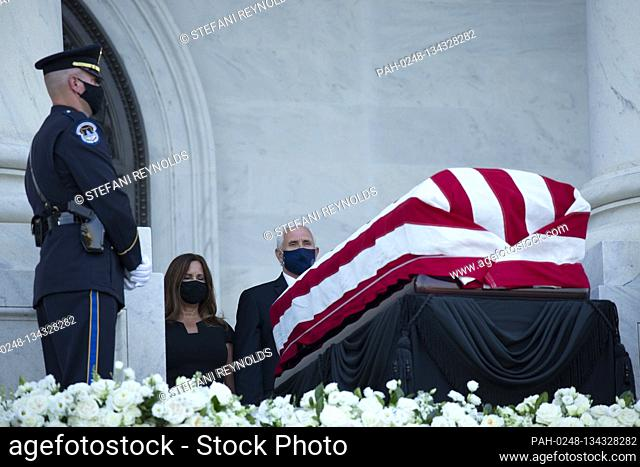 Karen Pence, left, and United States Vice President Mike Pence pay their respects as Representative John Lewis (Democrat of Georgia) lies in state on the steps...