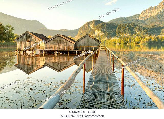 Boat hut at Kochelsee at daybreak against Herzogstand, Upper Bavaria, Bavaria, Germany