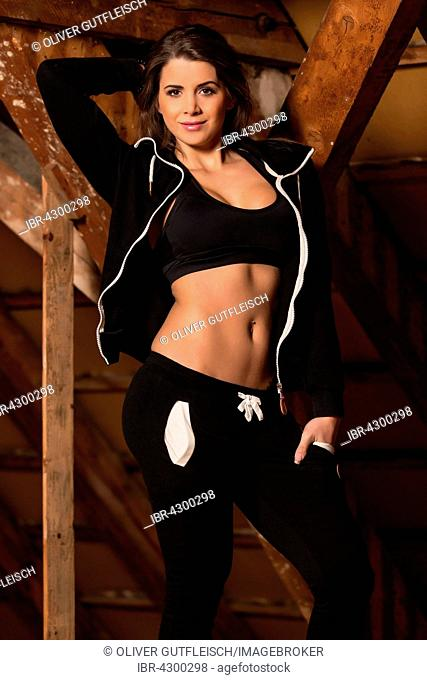 Young woman in a black fitness sports outfit