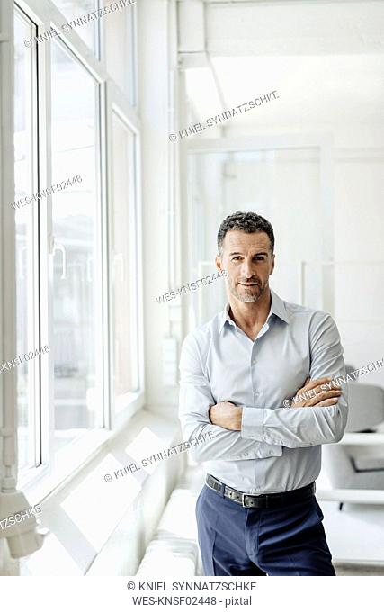 Portrait of confident businessman at the window