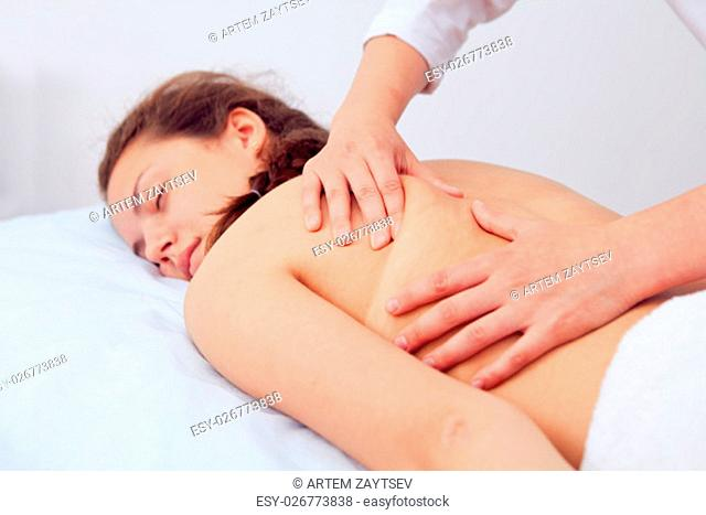 Spa Woman. Beauty Treatment. Beautiful Young Healthy Caucasian Girl Relaxing With Hand Massage Procedure In The Spa Salon. Masseur Massaging Her Back