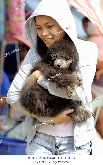 girl with her dog , big buddha statue at Pasak Jolasid Dam , Ban Kaeng Sua Ten , near Lopburi , Central Thailand