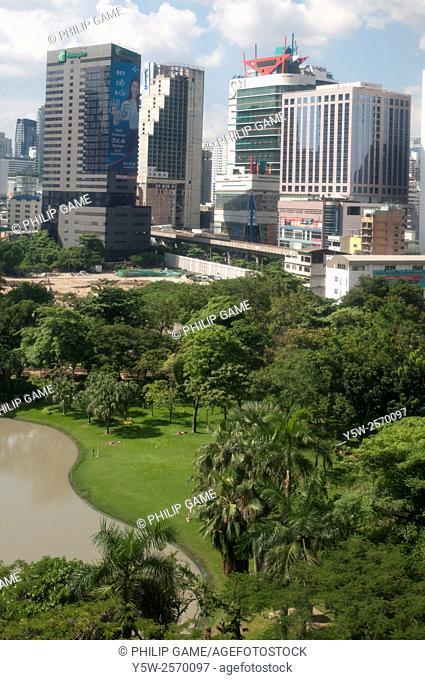 Apartments and office towers seen across Benjasiri Park, Sukhumvit Road, Bangkok, Thailand