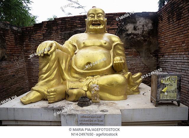 Laughing fat Buddha Ayutthaya City, Thailand, Asia. Near Wat Phu Khao Thong, Golden Mount. Religion, ruined, Symbol, Smiling, Statue