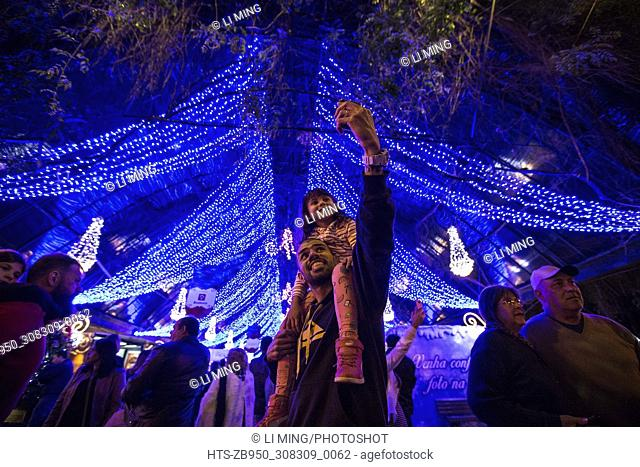 "(171201) -- GRAMADO(BRAZIL), Dec. 1, 2017 () -- A father takes selfie with his daughter during the 2017/2018 Gramado """"Natal Luz"""" (Christmas lights in English)..."
