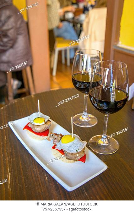 Two glasses of red wine with tapas in a bar. Madrid, Spain
