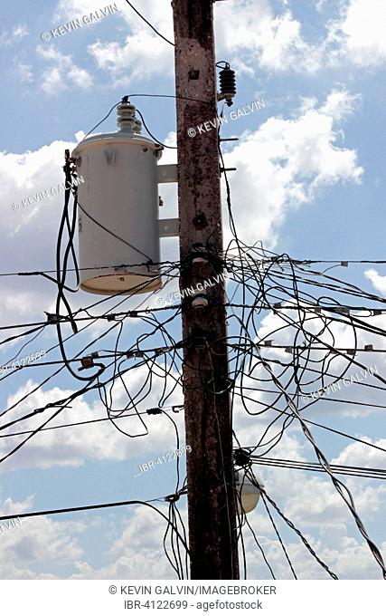 Many electricity wires and a transformer on a pole, Zapata Peninsula, Cuba