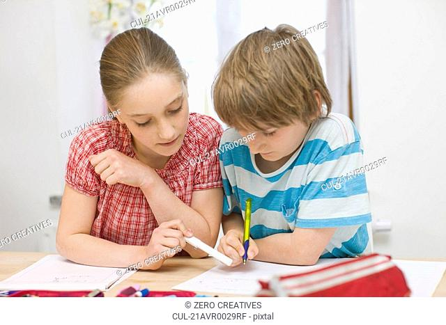 Boy and girl doing homework