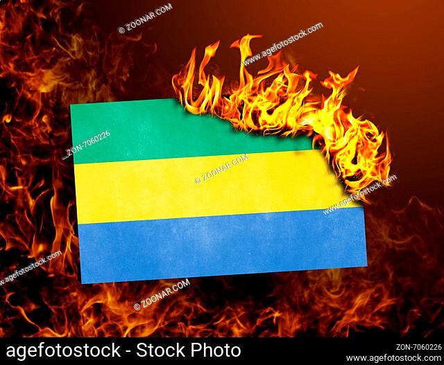Flag burning - concept of war or crisis - Gabon