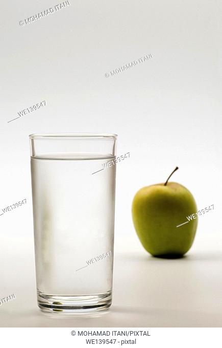 Glass of water and apple