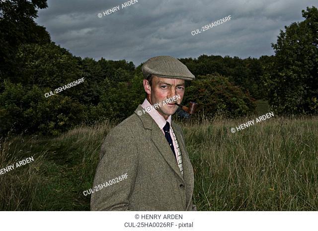 Country man smoking pipe
