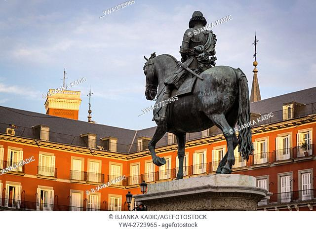 Bronze statue of King Philip III, Plaza Mayor, landmark square built in 17th century, Madrid, Spain