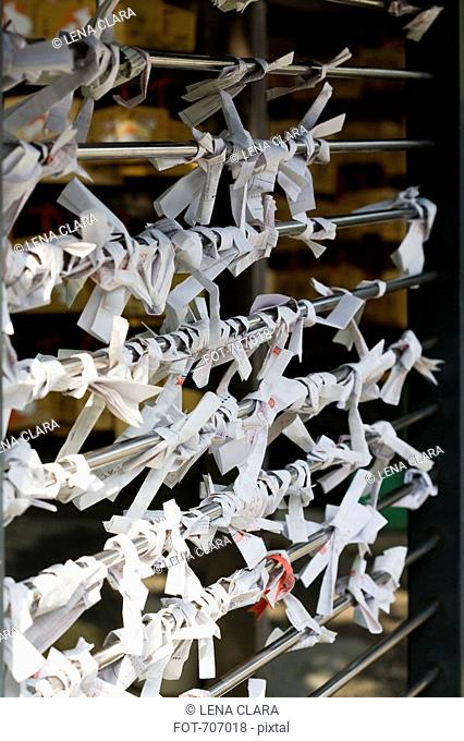 Prayers tied to a rack at Japanese temple