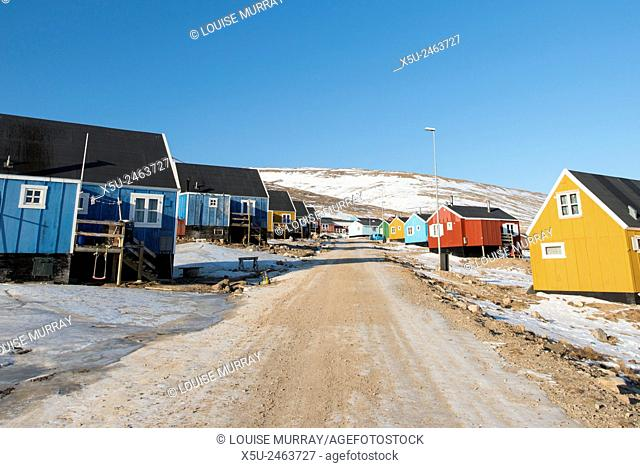 Colourful wooden houses in the village of Qaanaaq, one of the most northerly human settlements on the planet and home to 656 mostly Inuit people