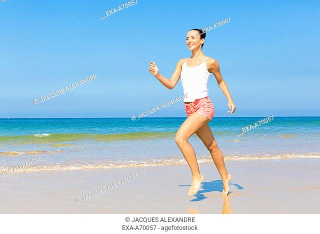 woman exercises at the beach