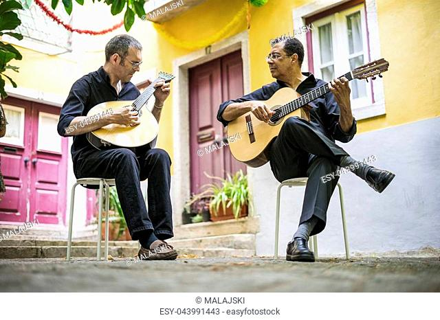 Two fado guitarists with acoustic and portuguese guitars in Alfama, Lisbon, Portugal