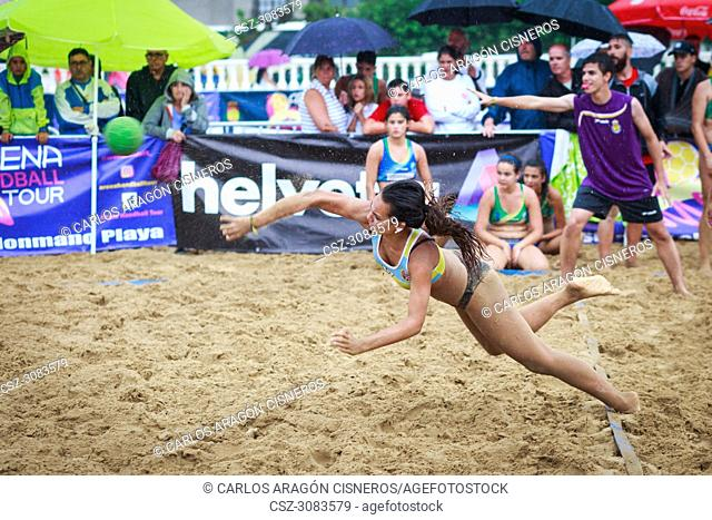 LAREDO, SPAIN - JULY 30: Unidentified girl player launches to goal in the Spain handball Championship celebrated in the beach of Laredo in July 30