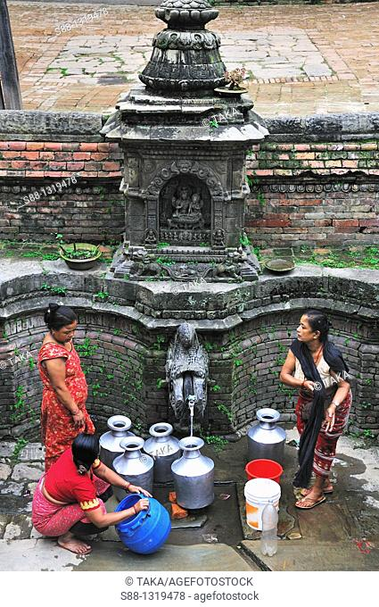 People come to get water at Durbar square, Bhaktapur (Bhadgaon), Kathmandu Valley, Nepal