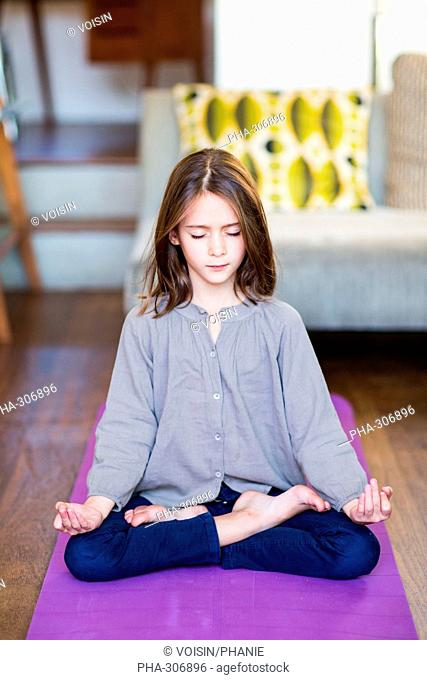 8 year-old girl practice relaxation exercises