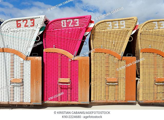 Sky with beach chairs in a row seen from side, Amrum, North Frisian, Schleswig-Holstein, Germany, Europe