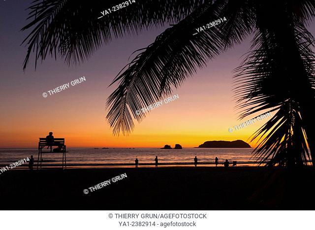 Costa Rica. Pacific coast, Puntarenas province, Manuel Antonio, Playa Espadilla beach at sunset, back islas Gemelas, Latin America