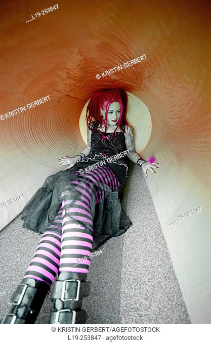 Young alternative woman lying in tunnel